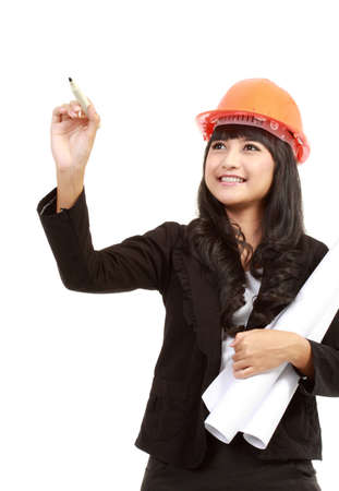 Female engineer with a pen writing isolated over a white background photo