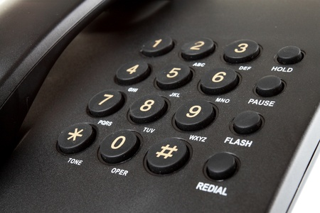 dialing: close up Digital desk phone isolated on a white background