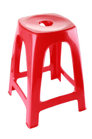 tacky: red plastic chair on isolated white background Stock Photo
