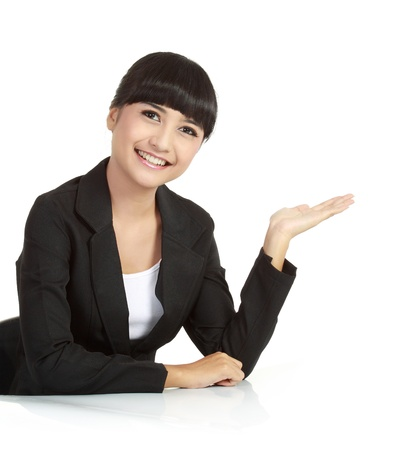 Beautiful business woman showing something with her hand, isolated on white background. photo