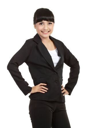 Portrait of a confident young business woman standing against white background Stock Photo - 11093069
