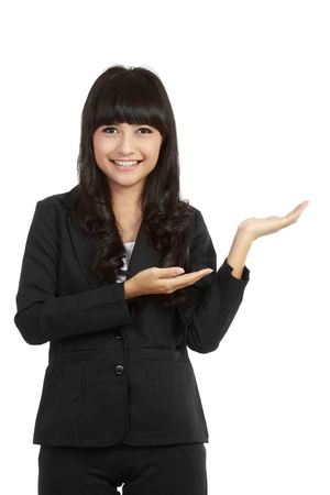 Beautiful business woman showing something with her hand, isolated on white background. Stock Photo - 11093071