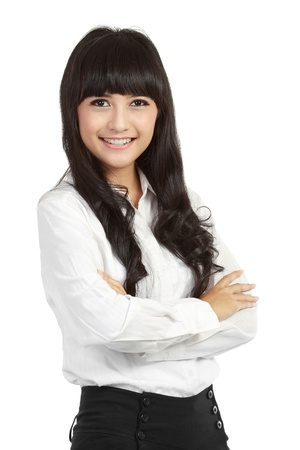 Portrait of a happy young business woman standing with folded hand against white background Stock Photo - 11093096