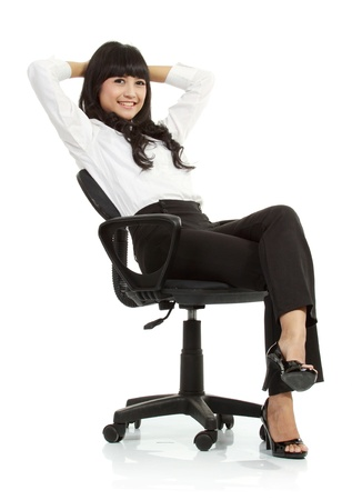 gorgeous young woman sitting on a chair isolated over white background Stock Photo - 11093008