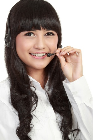 Portrait of a successful female call centre employee wearing a headset. in whte background photo