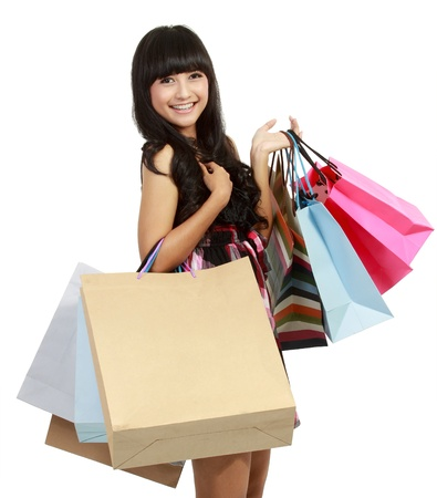 Shopping woman happy smiling holding shopping bags isolated on white background Stock Photo - 11093043