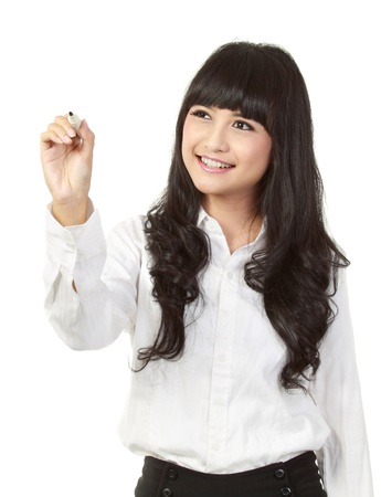 asian business woman: Young woman drawing something on screen with a pen - isolated over a white background