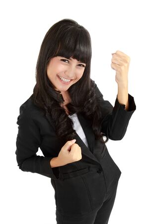 Cute young asian business woman celebrating success in isolated background photo