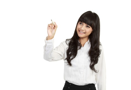 glassboard: Happy smiling cheerful young business woman writing or drawing on screen with black marker, isolated on white background