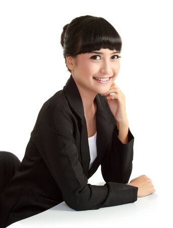 Beautiful smiling businesswoman looking at camera in isolated background photo