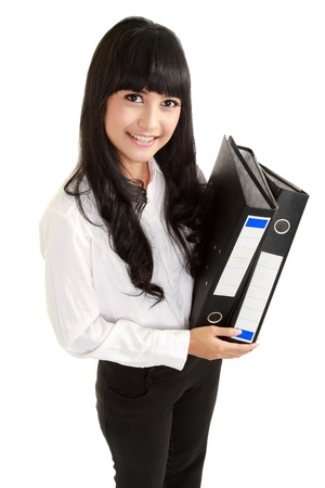 Portrait of a beautiful young business woman holding a folder, full length in isolated background