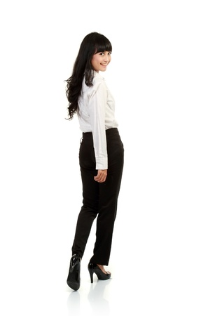 a portrait of asian business woman look back, with isolated background photo