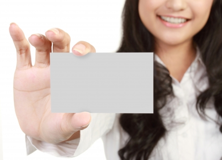 notecard: Business card or white sign - Portrait of a beautiful business woman holding a blank notecard. isolated white background Stock Photo