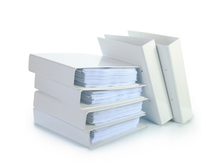 manuals: Stack of documents in white binders against white background. Office life.