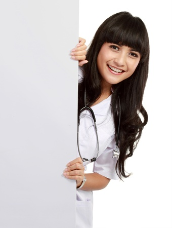 beautiful woman doctor with an empty board in isolated white background photo