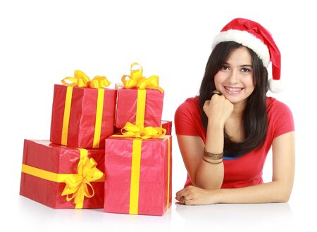 Happy girl in santa hat with pile of xmas gifts  isolated on white background Stock Photo - 11318401