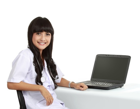 ordinary woman: Female doctor at work use laptop in isolated background