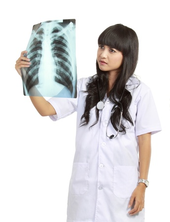 Female doctor examining an x-ray isolated over white background photo