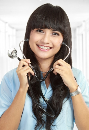general practitioner: Smiling medical doctor with stethoscope. Isolated over white background Stock Photo