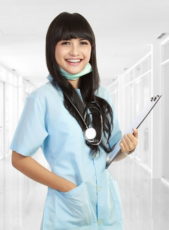 Smiling medical nurse with stethoscope. Isolated over white background photo
