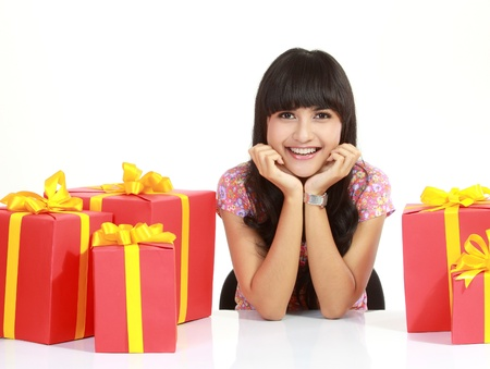grateful: Cute young woman surrounded by packages, isolated over white background