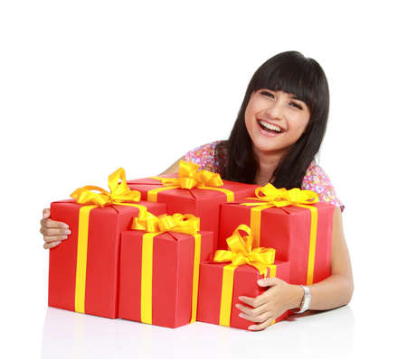 boxs: a portrait of attractive asian santa woman with a lot of gift boxs. isolated white background