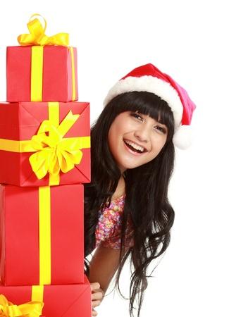 santa woman shopping holding many gifts wearing santa hat smiling happy. Beautiful female model isolated on white background. Stock Photo - 11318480