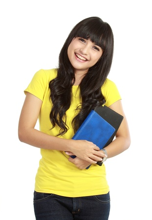 carrying girl: beautiful young woman holding books. isolated on white background