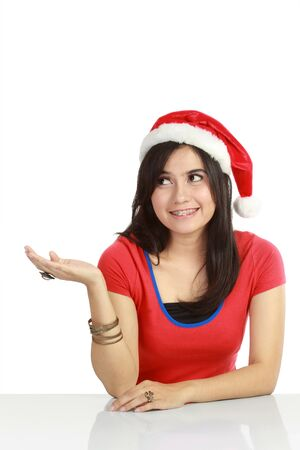 hand over: Christmas woman showing something with her hand. Isolated over white background Stock Photo