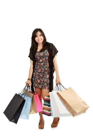 Shoping: Attractive Young beautiful asian Woman with Shopping Bags in white background