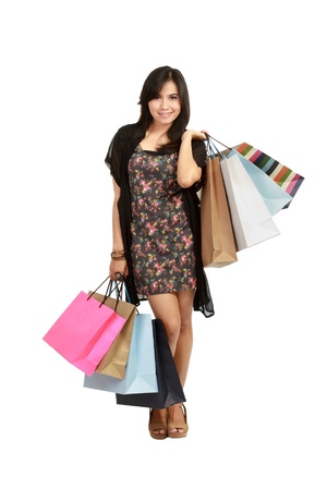 Shoping: cute Young  asian Woman with Shopping Bags in isolated white background Stock Photo