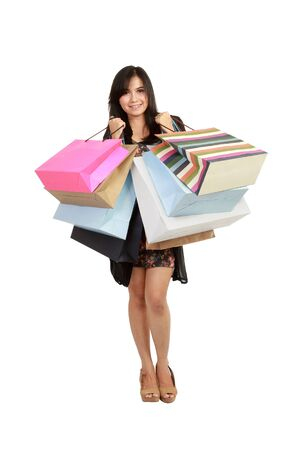 Attractive Young beautiful asian Woman with Shopping Bags in white background photo