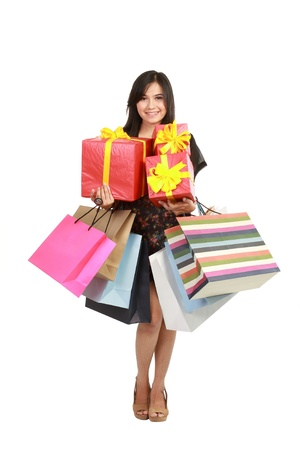 Shoping: Attractive Young beautiful asian Woman with Shopping Bags and Box white isolated background Stock Photo