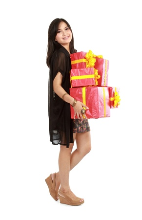Cute laughing girl holding the red box present over white background Stock Photo - 11315526