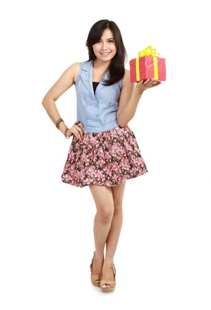 Cute laughing girl holding the red box present over white background Stock Photo - 11318371