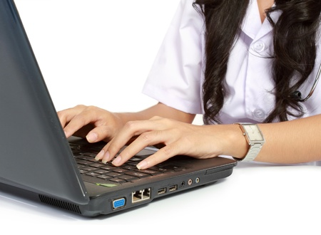 Close Up Female doctor working with laptop isolated over white background photo