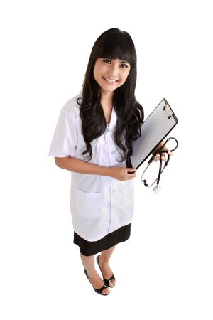 Happy smiling female doctor holding a clipboard, isolated on white background photo