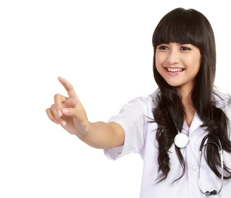 Closeup portrait of young female surgeon pointing at copyspace isolated white background photo