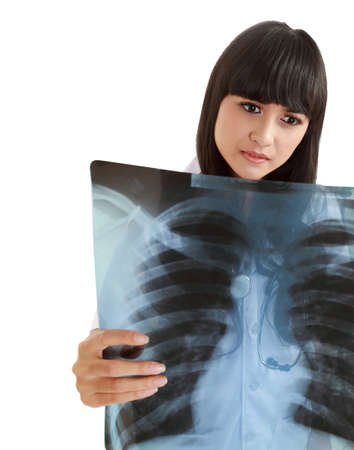 Female Nurse Looking At A Patients Chest X-Ray Wearing Hospital Scrubs photo