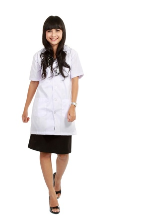 full length woman: Nurse standing isolated over white background. asian woman nurse or young medical doctor smiling in full length.