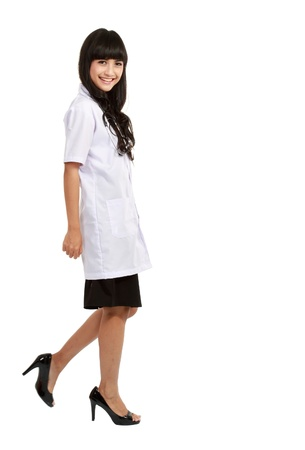 Nurse standing isolated over white background.asian woman nurse or young medical doctor smiling in full length. photo