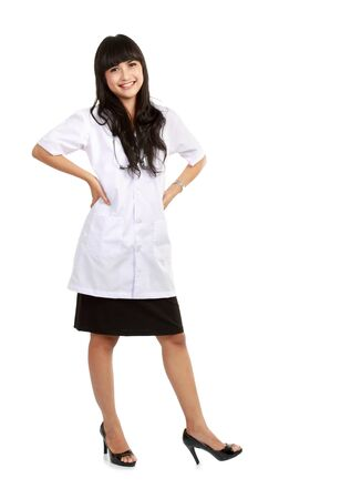 Beautiful Female doctor standing alone in white background photo