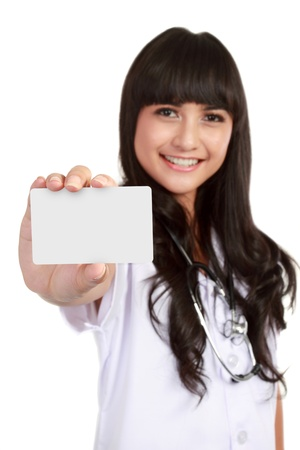Nurse or young medical doctor woman showing business card isolated on white background. Closeup with copy space on blank empty sign. photo