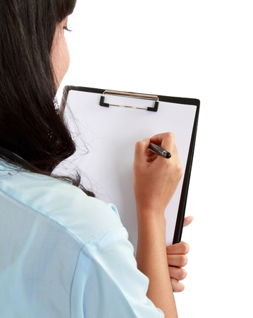 taking notes: Cheerful medical doctor woman taking notes. Isolated on white Stock Photo