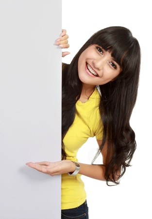 Beautiful woman holding empty white board isolated over white background photo