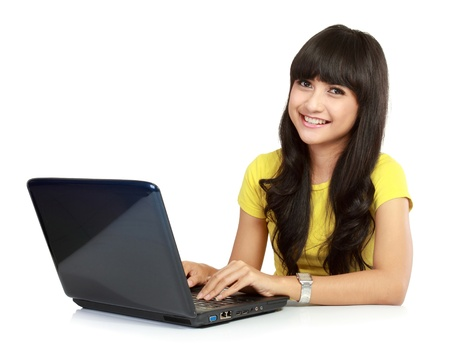 asian on laptop: Beautiful smiling woman with laptop. Isolated over white background Stock Photo