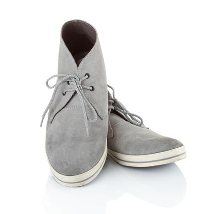 untied: par de zapatillas hombres grises en aisladas sobre fondo blanco Foto de archivo