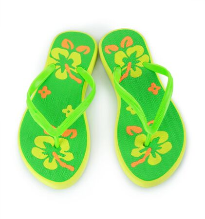 a pair of green beach sandals isolated on white photo
