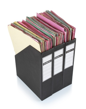 collects: Stack of documents in binders against white background. Office life.