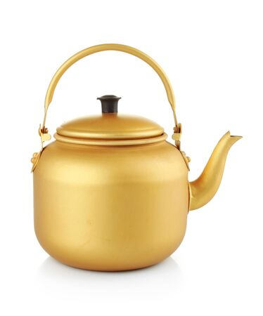 A gold tea kettle on a white background with copy space photo